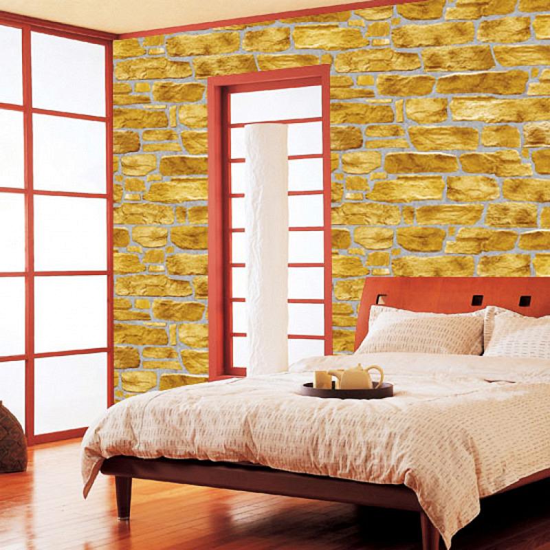 Tapete selbstklebend Steinmauer Kiesel gelb